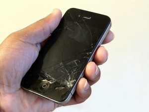 Hand Holding Cracked Smartphone