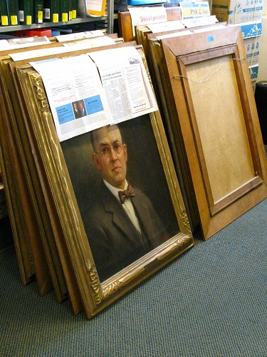 Restored portraits await return to walls
