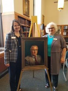 MSBA CEO Cheryl Dalby and RCBA CLE & Events Director Sharon Elmore with the portrait of Judge Otis H. Godfrey, Jr.