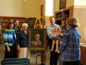 The family of Judge Godfrey with his portrait.