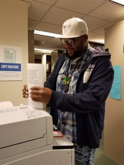Dennis Lee Lamar Bell, Jr. is making copies of his expungement paperwork at the Ramsey County Law Library.